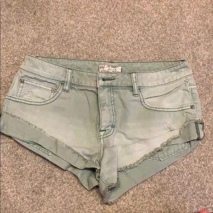 Green free people jean shorts